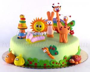 Baby Tv torta na zelenoj podlozi sa dugom