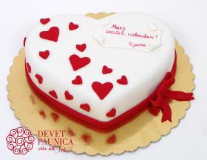 Belo srce sa malim crvenim srcima