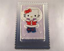 Torta Hello Kitty deda Mrazica dekoracija šlagom